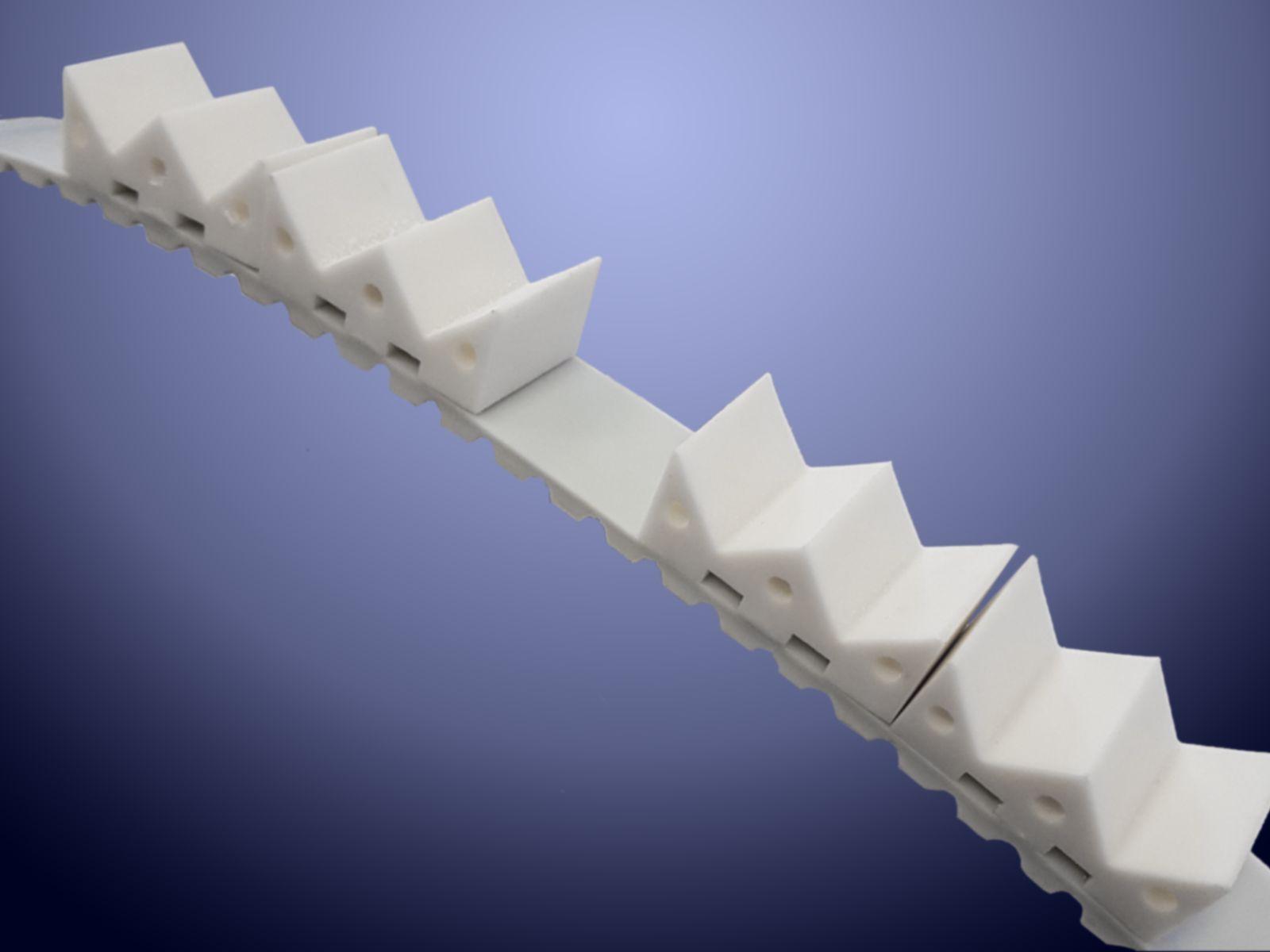Le cinghie dentate con tasselli saldati sono utilizzate nel packaging e nell'automazione